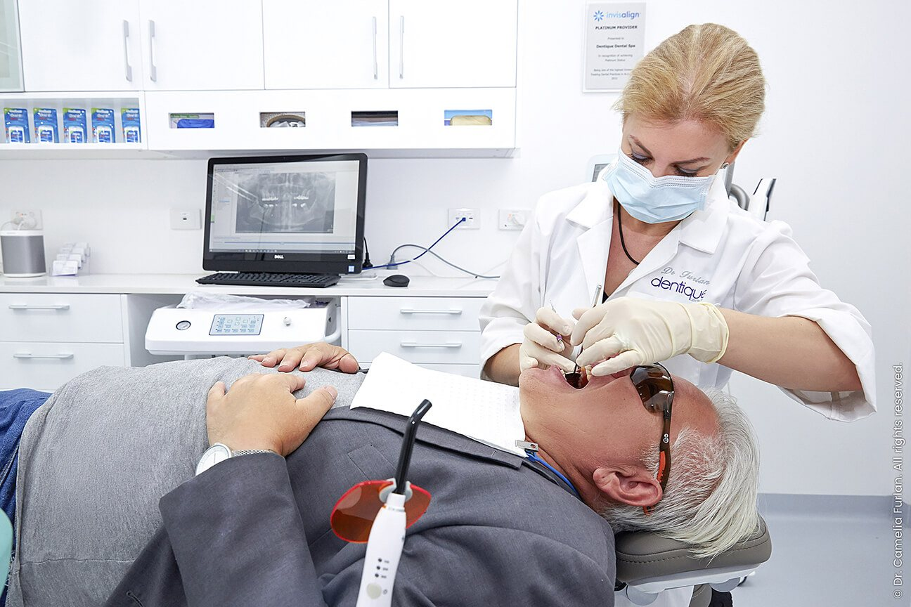 man having a dental procedure done by dentist Dr Furlan